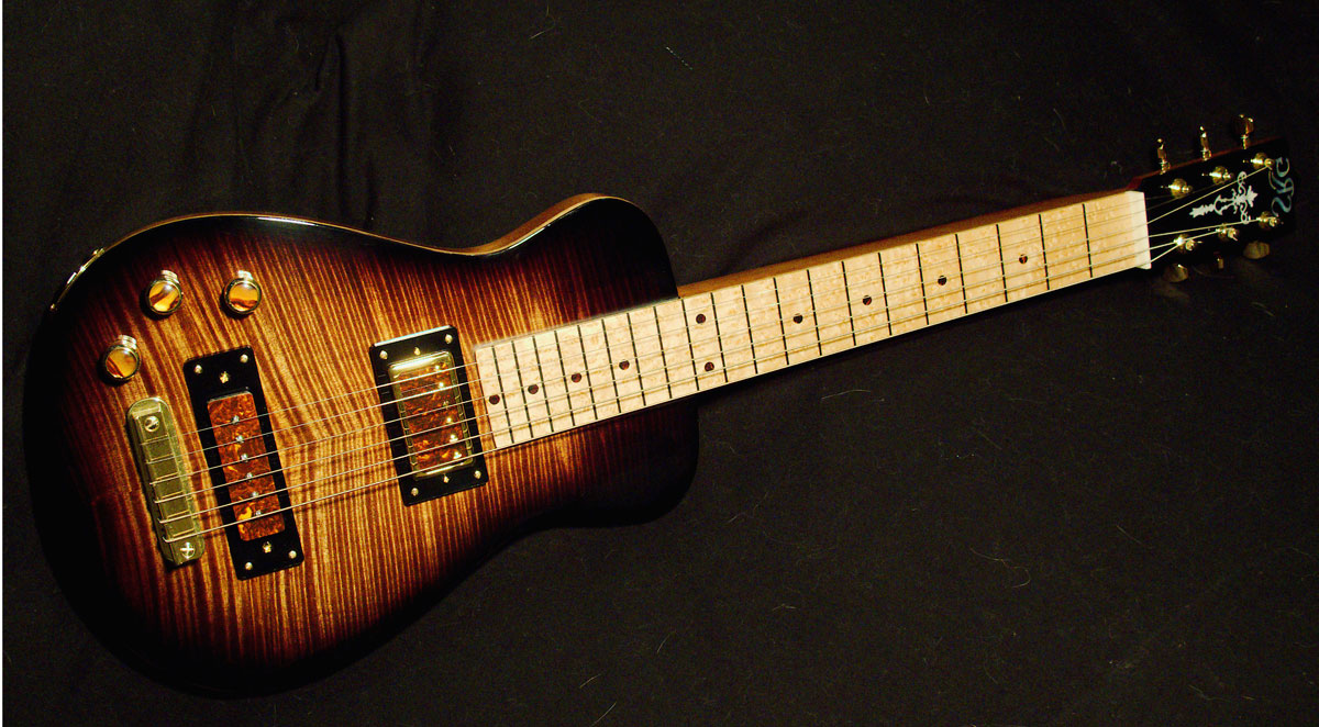 SCANTIC RIVER LAPSTEEL The Scantic River Guitar Company offers finer craftsmanship and taste in their custom lap steels than you'll find in the vast majority of full-sized guitars. The SRG-504 we tested showcases just how good it can get. (Guerra)