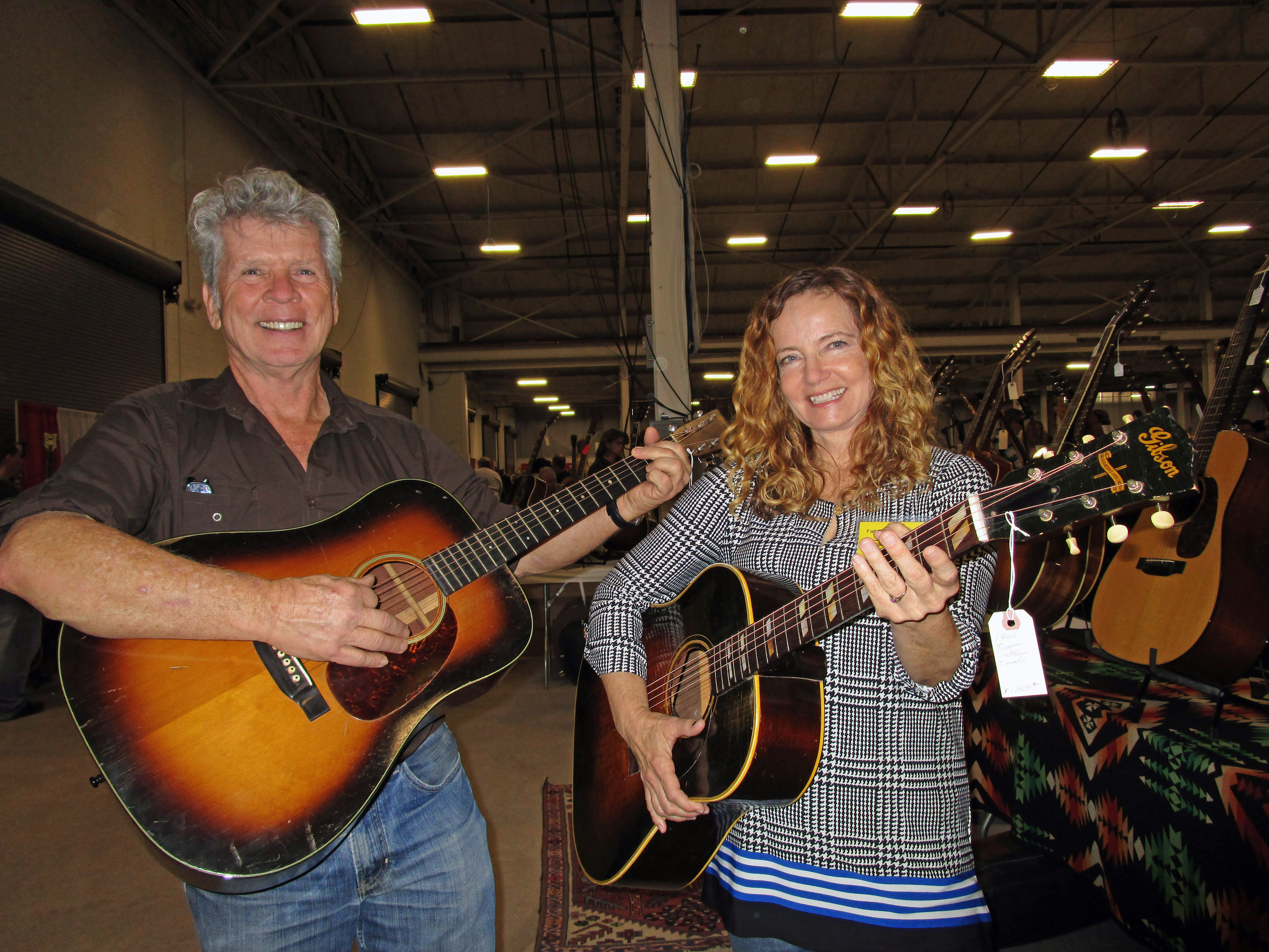 Show promoters Gary and Bonnie Burnette of Bee-3 Vintage with a '39 Martin D-18 shaded-top and '44 Gibson Southern Jumbo