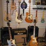 TOP - 84 Ibanez Pro Line,87 American Standard Strat with custom rosewood pick guard, 86 Ibanez Talman, - BOTTOM -2012 Tweedy SG, 1969 LP Delexe/conversion. AMPS -Bogner Duende-mono, Custom Rack with Crown DC 300 and two Yammaha SM12s for stereo. LITTLE GUYS UP TOP- Yamaha Guitilele and Washburn Mando.