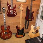 TOP - Schecter Diamond Elite 12 string,  Schecter Diamond Elite 5 string bass. BOTTOM - Ibanez 2002 Artcore arch top, 1980 Electra Phoenix bass, 2005 Wechter Pathmaker Lacewood.  LITTLE GUYS UP TOP- Raisin Band!