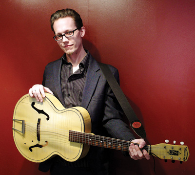 "Mike Keller with his ""house"" guitar, a '50s Harmony archtop."