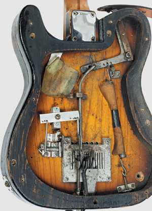 Design of the historic Parsons/White StringBender in Marty Stuart's Clarence exposed. Later production models of the mechanism are fitted in – rather than on – the guitar back. The greenish paper holds Stuart's settings for a particularly satisfying sound – illegible from years of soaking with WD-40.