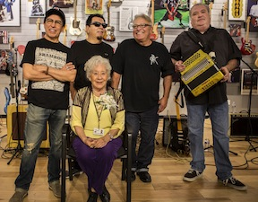 Abigail Ybarra (seated) with Los Lobos.