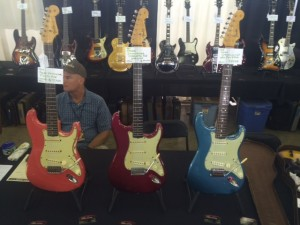 Three shades of Stratocaster - '63 Fiesta Red, '64 Candy Apple Red, and '65 Lake Placid Blue.