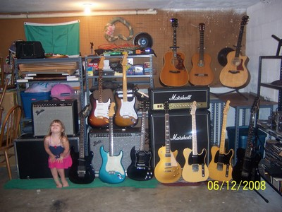Emma and her daddy's guitars