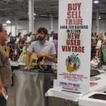 Jeremy Cain, Cream City Guitars' guitar tech, helps customer.