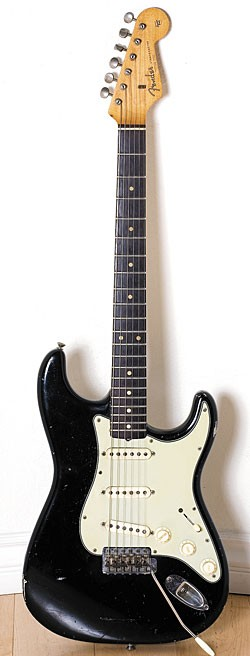 Late-'64/mid-'65 Fender Stratocaster in black.