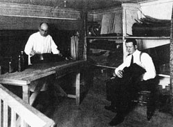 Francisco Simplicio (left) and son, Miguel, applying French polish in their shop.